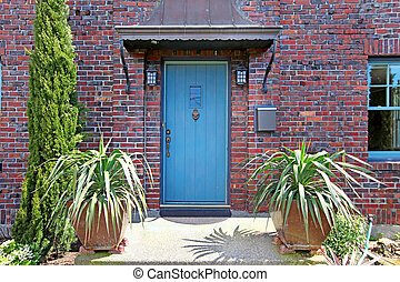 Blue front door of the old brick house in Tacoma, WA