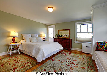 Cozy bedroom with white bedding - Green fresh bathrooms with...
