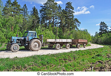 Tractor with trailer on country road - Tractor with trailer,...