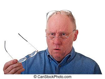 Older Balding Man Confused Over Reading Glasses - An older...