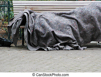 Homeless - Homeless people sleeping outside in the cold on a...