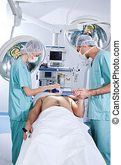 Patient being operated by the surgeons