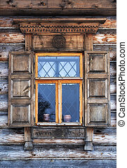 Window in old wooden country house - Window with wooden...