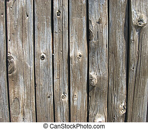 texture of real brown antique wood panels with knots and...