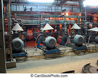 Electric motors driving water pumps at power plant, night...