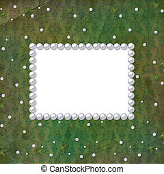 Frame for photo with pearls on the grunge background