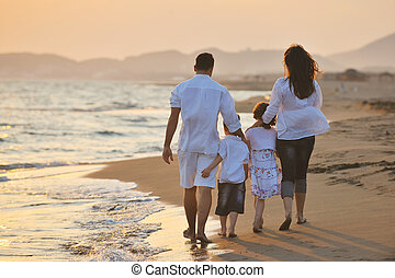 happy young family have fun on beach at sunset - happy young...