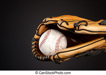 Baseball and glove - A baseball and baseball glove sports...
