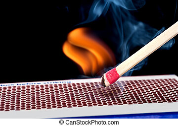 Matchstick on fire - A matchstick lights after it is struck...