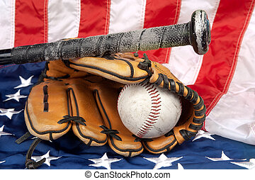 Baseball equipment on American flag - A baseball glove,...