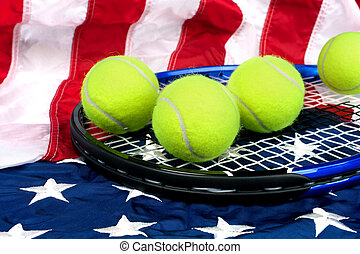 Tennis equipment on American flag - A tennis raquete with...