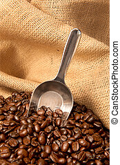 Coffee beans in burlap sack with scoop