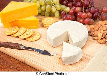 Cheese tray with fruit - A cheese tray with fruit, crackers...