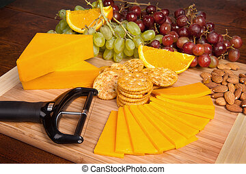 Cheese and snack tray - A tray of cheese and fruit snacks...