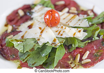 Beef carpaccio a la carte meal - Closeup detail of a beef...