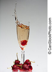 Strawberry and champagne - A strawberry splashing in to a...