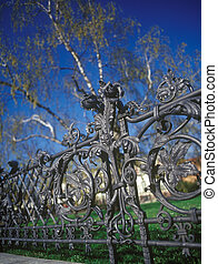 A wrought-iron fence.