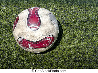 Used Football ball on the field