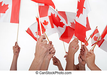 Happy Canada Day Raised hands waving Canadian flags