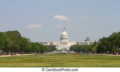 US Capital From Mall - Tourists and vacationers roam about...