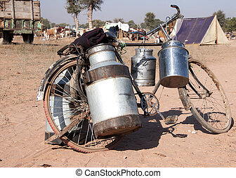 Bike with milk canisters on its side at Nagaur's cattle fair...
