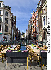 Outdoor terrace restaurant on the canal in Amsterdam. Urban scene