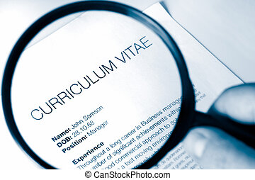 magnifying glass and cv - idea for examing a cv for a job...