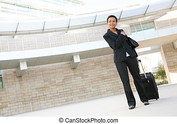 Business Woman Travelling - A pretty african american...