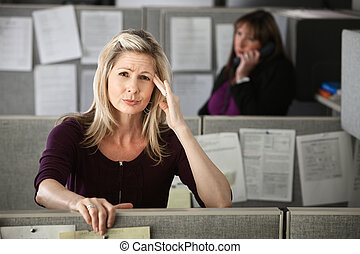 Woman in Office with Headache - Stressed-out office worker...