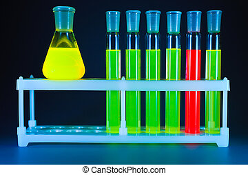 Six test tubes, one flask - Five test tubes with a green...