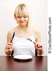 Woman eating nutritional supplement - pills on plate