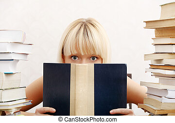 Student woman with lots of books studying for exams - Young...