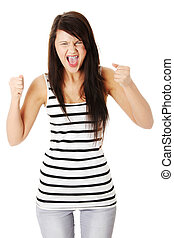 Very upset and angry woman screaming and clenching her...