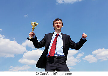 young businessman  with a golden cup