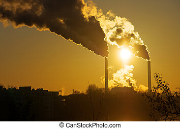 Sunrise and smokestacks - Sunrise and two smokestacks from a...