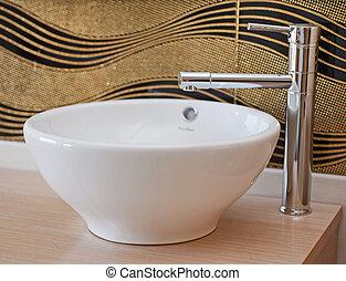 Bathroom washbasin and tap - Washbasin in a bathroom with...