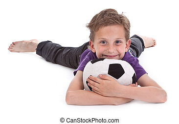 small boy with football on white background