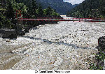 walking bridge over fraser river - a red foot bridge over...