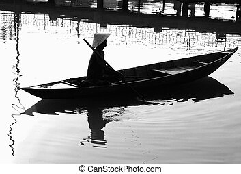 composure - Asian fisherman in his boat