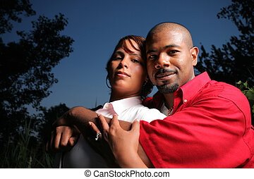 Happy couple together outdoors - Happy African American...