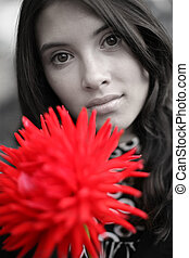 Beautiful woman with red flower, close-up.