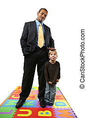 Businessman and child - Tall African American businessman...