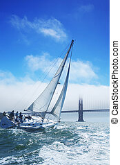 Beautiful yacht in San Francisco bay, Golden Gate bridge on...