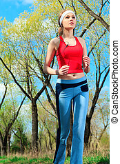 jogger - Young sporty woman is jogging outdoor