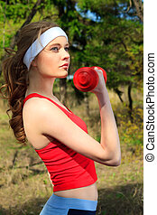work out - Young sporty woman is working out outdoor.