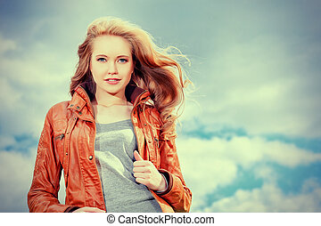nature - Beautiful young woman outdoors over blue sky.