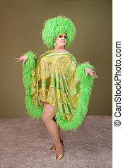 Drag Queen Performs - Large drag queen in green dress and...