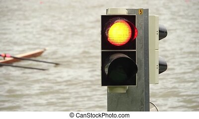 Start signal at a rowing regatta - The starting lights turn...