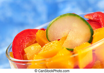 Fresh salad of mango, red bell pepper and cucumber (Very Shallow Depth of Field, Focus on the upper edge of the cucumber)