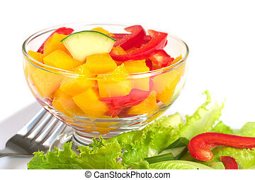 Fresh salad of mango, red bell pepper, cucumber and lettuce (Selective Focus, Focus one third into the bowl)